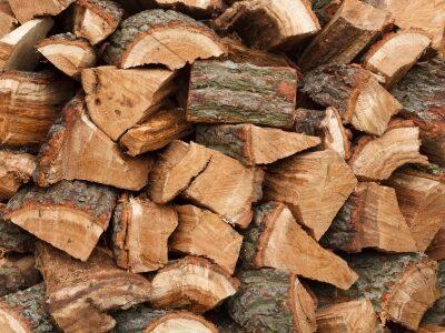 15369116 - closeup of a wood pile with chopped oak firewood